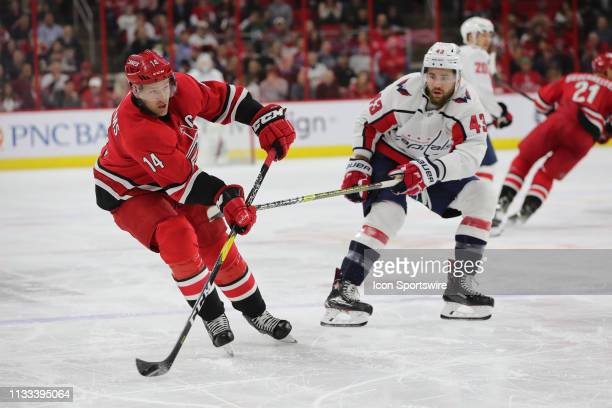Carolina Hurricanes right wing Justin Williams goes to shoot the puck with Washington Capitals right wing Tom Wilson behind during the 3rd period of...
