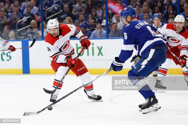 Carolina Hurricanes right wing Justin Williams is defended by Tampa Bay Lightning defenseman Anton Stralman in the first period of the NHL game...