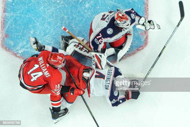 Carolina Hurricanes Right Wing Justin Williams knocks Columbus Blue Jackets Defenceman Scott Harrington to the ice in front of Columbus Blue Jackets...