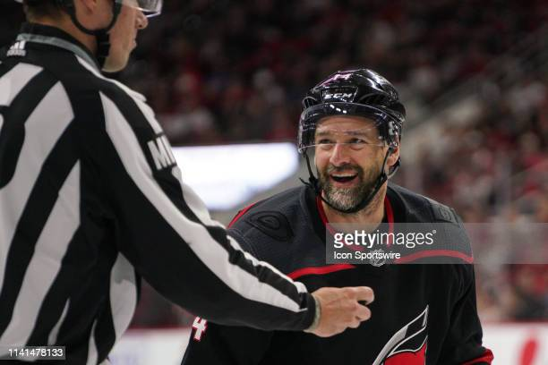 Carolina Hurricanes right wing Justin Williams laughs after being thrown out of the face-off circle during a game between the Carolina Hurricanes and...