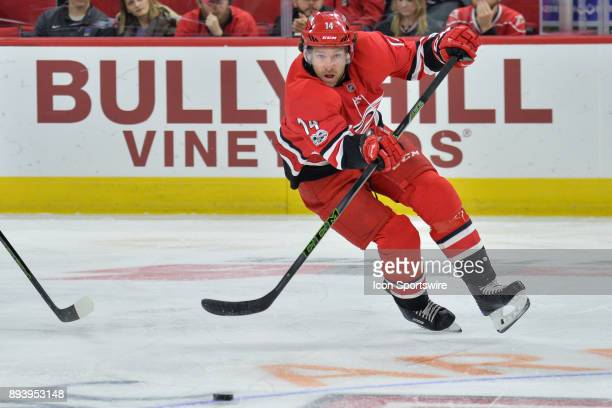 Carolina Hurricanes Right Wing Justin Williams passes the puck across the ice during a game between the Carolina Hurricanes and the Columbus Blue...