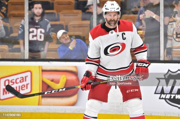 Carolina Hurricanes right wing Justin Williams passes the puck back and forth with a teammate in warm ups. During Game 1 of the Eastern Conference...