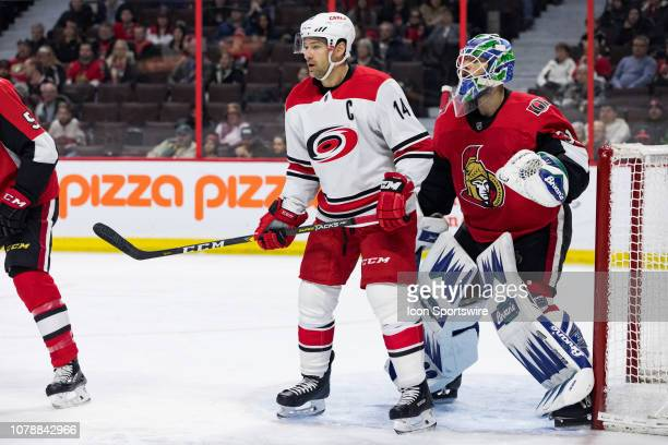 Carolina Hurricanes Right Wing Justin Williams screens Ottawa Senators Goalie Anders Nilsson during third period National Hockey League action...