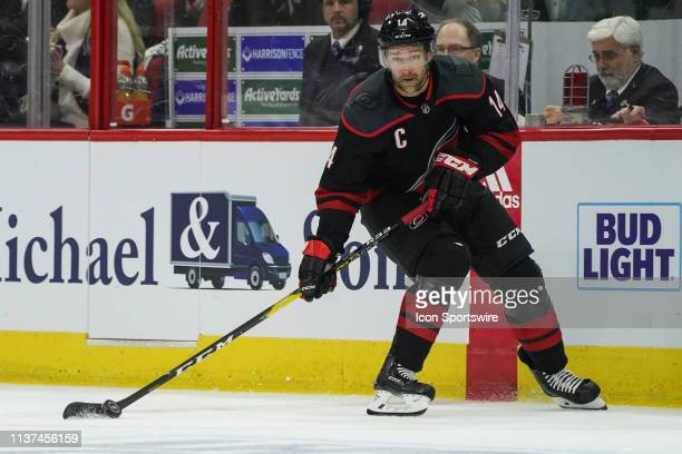 Carolina Hurricanes right wing Justin Williams skates the puck up ice during a game between the Carolina Hurricanes and the Washington Capitals at...