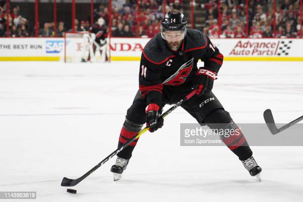 Carolina Hurricanes right wing Justin Williams skates the puck up ice during a game between the Boston Bruins and the Carolina Hurricanes on May 14,...
