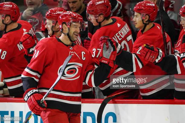 Carolina Hurricanes Right Wing Justin Williams winks at Carolina Hurricanes Center Sebastian Aho after getting congratulated by the bench for scoring...