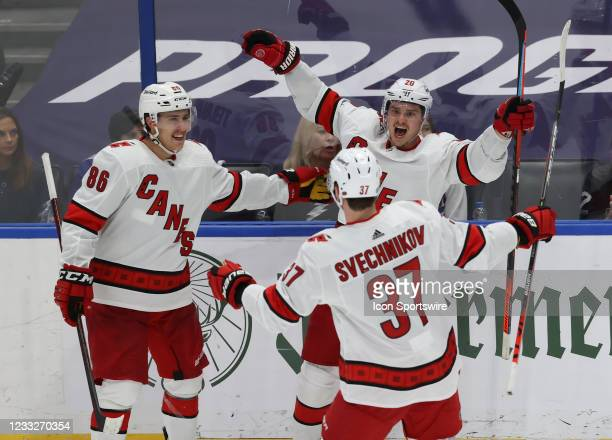 Carolina Hurricanes right wing Sebastian Aho celebrates with Andrei Svechnikov and Martin Necas after scoring a goal in the second period of Game 3...