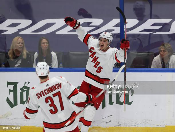 Carolina Hurricanes right wing Sebastian Aho celebrates with Andrei Svechnikov after scoring a goal in the second period of Game 3 of the Second...
