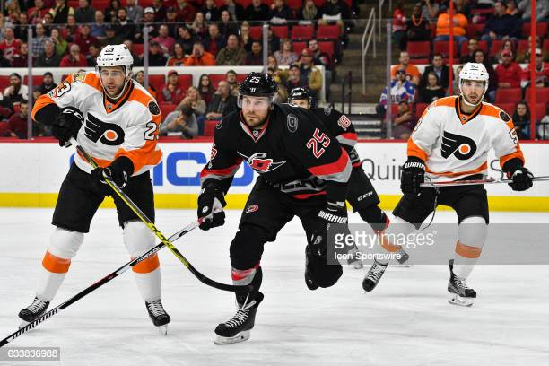 Carolina Hurricanes Right Wing Viktor Stalberg skates after a puck in front of Philadelphia Flyers Defenceman Brandon Manning and Philadelphia Flyers...