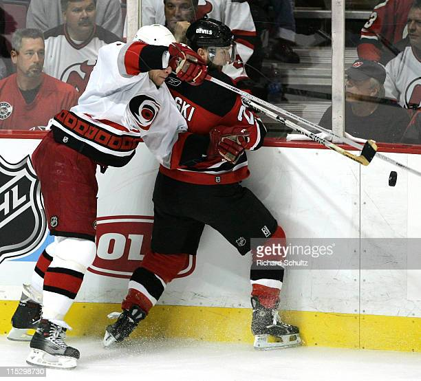 Carolina Hurricanes' Rod Brind'Amour battles Brian Rafalski of the New Jersey Devils during the third period of game three in the Eastern Conference...