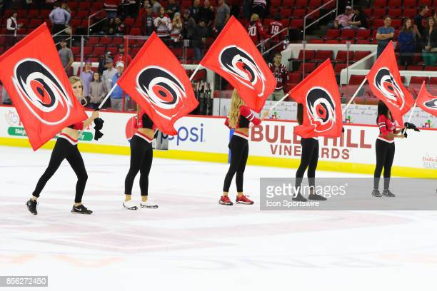 Carolina Hurricanes Storm Squad celebrating a win during theCarolina Hurricanes game versus the Washington Capitals on September 29 at PNC Arena in...
