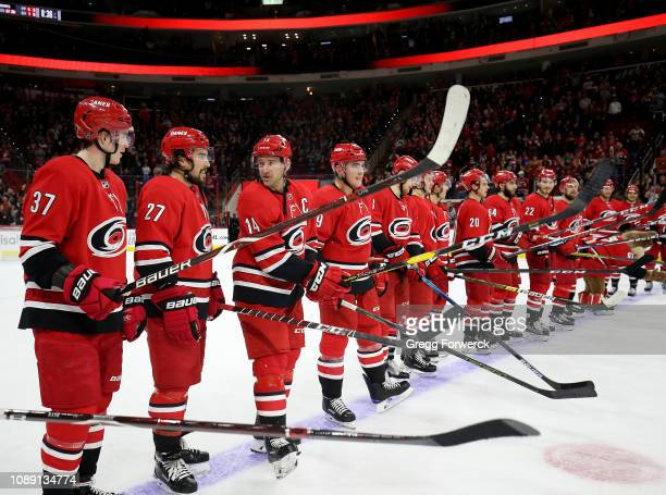 Carolina Hurricanes teammates prepare for the Storm Surge following a victory over the Philadelphia Flyers during an NHL game on December 31 2018 at...