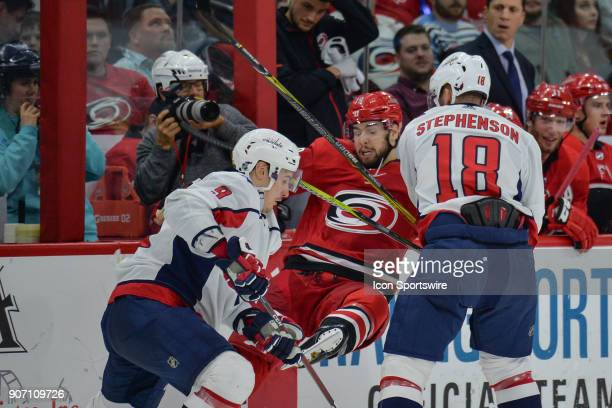 Carolina Hurricanes Winger Josh Jooris is checked along the boards by Washington Capitals Left Wing Chandler Stephenson during a game between the...