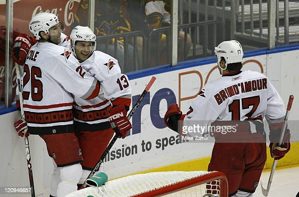 Carolina Hurricanes winger Ray Whitney celebrates the first goal of the game with Erik Cole and Rod Brind'Amour during the game between the Atlanta...