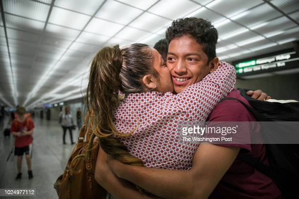 Carolina Isabel Iraheta de Hernandez is reunited with her sons Diego and Saul at Dulles International airport Carolina who now lives in Arlington...