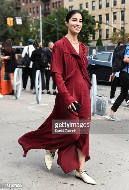 Carolina Issa is seen wearing a red dress outside the Tory Burch show during New York Fashion Week S/S20 on September 08 2019 in New York City