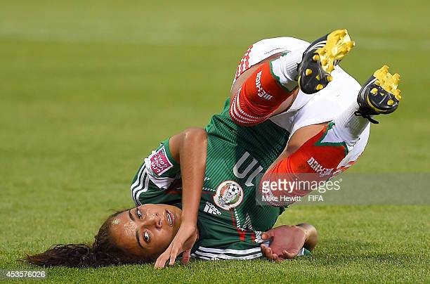 Carolina Jaramillo of Mexico falls to the pitch after a missed chance against Korea Republic during the FIFA U20 Women's World Cup Canada 2014 Group...