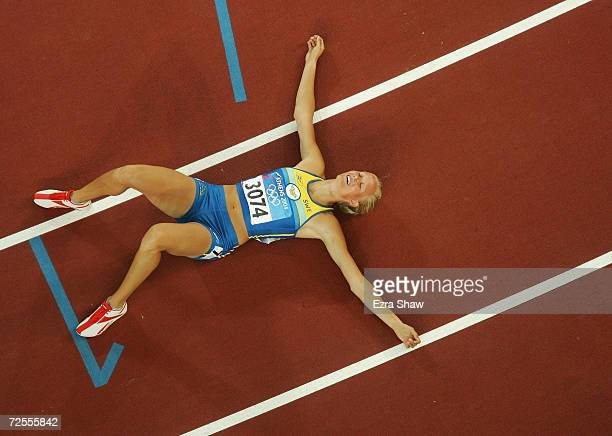 Carolina Kluft of Sweden celebrates after she won gold and after the 800 metre discipline of the women's heptathlon on August 21, 2004 during the...