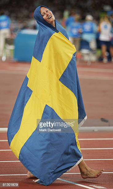 Carolina Kluft of Sweden celebrates after the 800 metre discipline of the women's heptathlon on August 21 2004 during the Athens 2004 Summer Olympic...