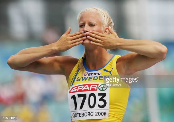 Carolina Kluft of Sweden celebrates following a successful jump during the High Jump discipline in the Women's Heptathlon on day one of the 19th...