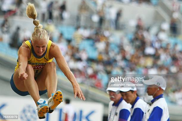 Carolina Kluft of Sweden competes in the Long Jump during the Women's Heptathlon on day two of the 11th IAAF World Athletics Championships on August...