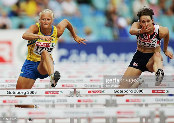 Carolina Kluft of Sweden competes with Kelly Sotherton of Great Britain during the 100 Metres Hurdles discipline in the Women's Heptathlon on day one...