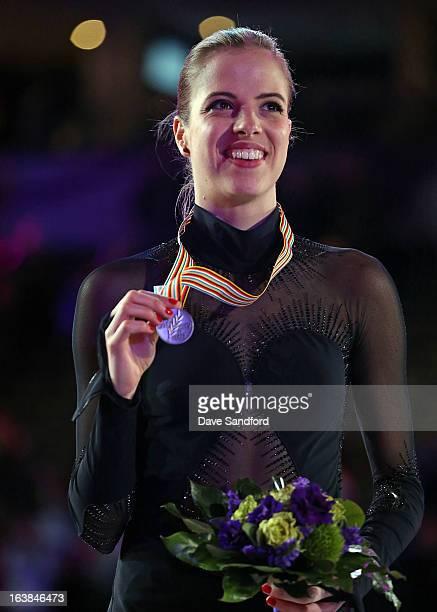 Carolina Kostner of Italy celebrates silver in the Ladies Free Skating Program during the 2013 ISU World Figure Skating Championships at Budweiser...