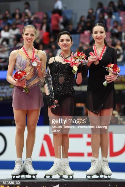 Carolina Kostner of Italy Evgenia Medvedeva of Russia Polina Tsurskaya of Russia pose on the podium in the medal ceremony during the ISU Grand Prix...