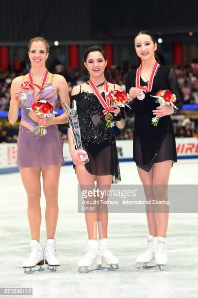 Carolina Kostner of Italy Evgenia Medvedeva of Russia Polina Tsurskaya of Russia pose with their medals during the ISU Grand Prix of Figure Skating...