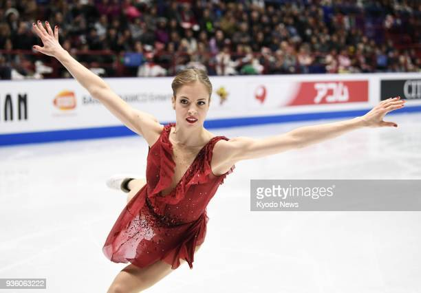 Carolina Kostner of Italy performs in the women's short program at the world figure skating championships in Milan on March 21 2018 ==Kyodo