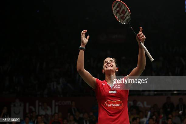 Carolina Marin of Spain celebrates after defeating Saina Nehwal of India in the Women's Singles final match of the 2015 Total BWF World Championship...