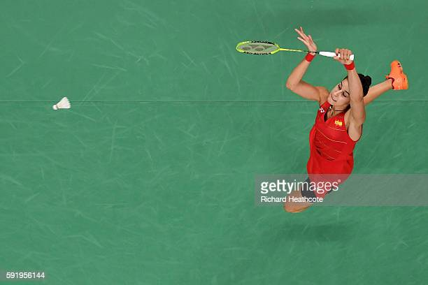 Carolina Marin of Spain competes against V Sindhu Pusarla of India during the Women's Singles Gold Medal Match on Day 14 of the Rio 2016 Olympic...