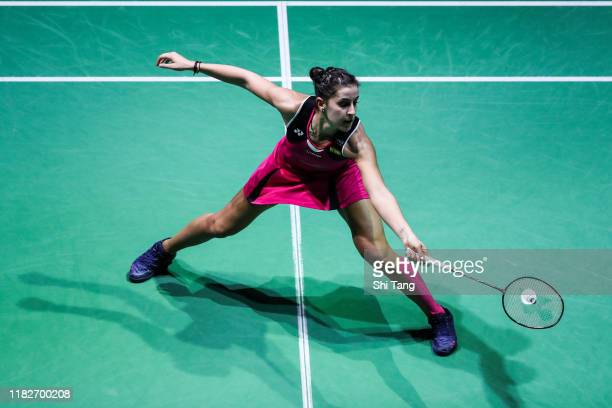 Carolina Marin of Spain competes in the Women's Singles first round match against Cai Yanyan of China on day one of the French Open at Stade Pierre...