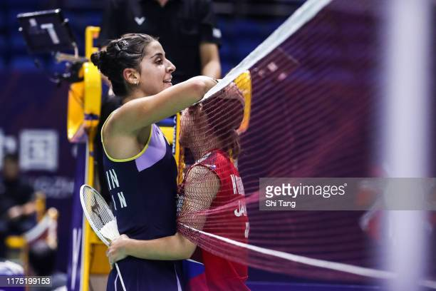 Carolina Marin of Spain greets Nozomi Okuhara of Japan after their Women's Singles first round match on day one of the China Open at Olympic Sports...