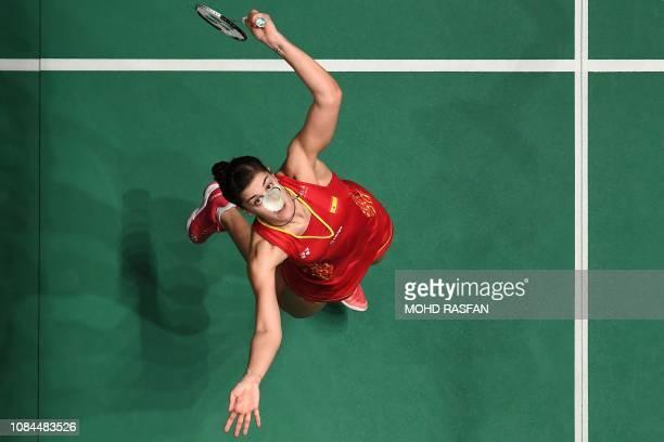 TOPSHOT Carolina Marin of Spain hits a return against Sung Ji Hyun of South Korea in their women's singles match at the Malaysia Masters badminton...