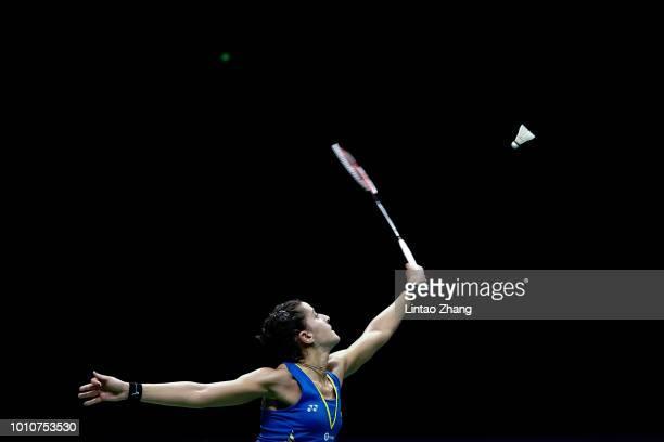 Carolina Marin of Spain hits a shot against He Bingjiao of China in their Women's Singles Semifinals match during the Badminton World Championships...