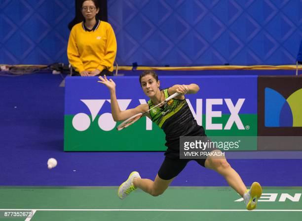 Carolina Marin of Spain hits a shot against Mnatsu Mitani of Japan during the Hong Kong Open badminton tournament in Hong Kong on November 22 2017 /...