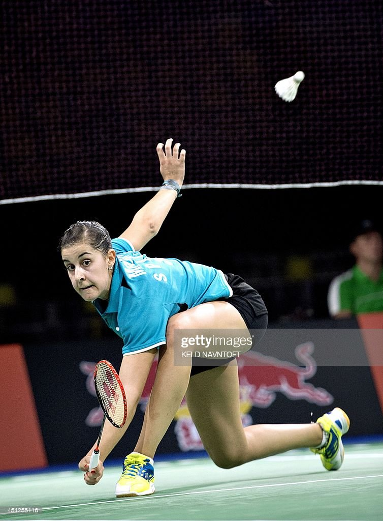 Carolina Marin of Spain in action against Jing Yi Tee of Malaysia during their match in mens single Badminton World Championship Ballerup Super Arena, in Copenhagen, on August 27, 2014. AFP PHOTO/ Scanpix DENMAR / Keld Navntoft / DENMARK OUT