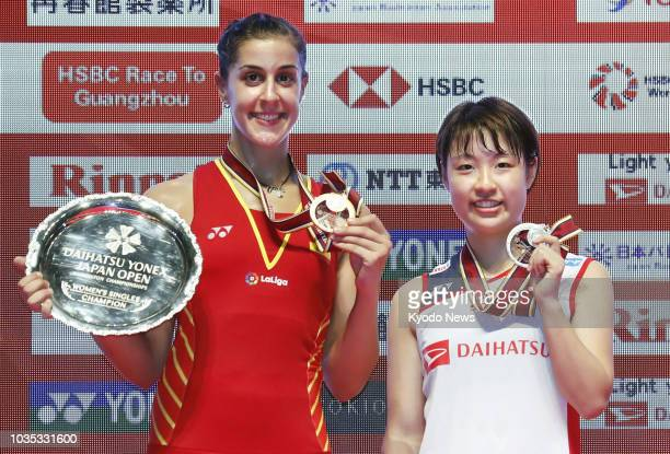 Carolina Marin of Spain poses after winning the women's singles at the Japan Open at Musashino Forest Sport Plaza in Chofu, Tokyo, on Sept. 16...