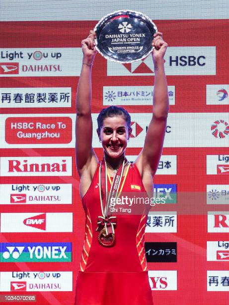 Carolina Marin of Spain poses with her trophy after the Women's Single final match against Nozomi Okuhara of Japan on day six of the Yonex Japan Open...