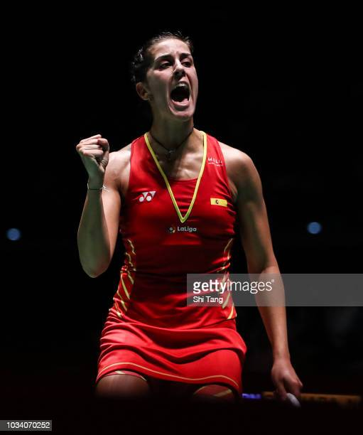 Carolina Marin of Spain reacts after a point in the Women's Single final match against Nozomi Okuhara of Japan on day six of the Yonex Japan Open at...