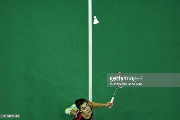 Carolina Marin of Spain returns a shot against Taiwan'sTai Tzu Ying during their women's singles semifinal match of the 2018 Malaysia Masters...