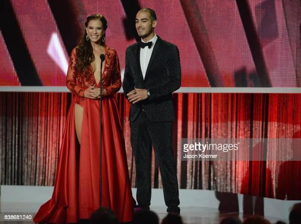 Carolina Miranda and Michel Duval on stage at Telemundo's 2017 Premios Tu Mundo at American Airlines Arena on August 24 2017 in Miami Florida