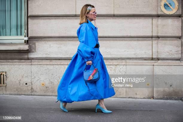 Carolina Ogliaro is seen wearing blue coat and belt Balenciaga, sunglasses with chain Sabine Be eyewear, Mulberry bag, Reikenen shoes during Paris...