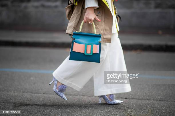 Carolina Ogliaro is seen wearing Boyy bag Rejina Pyo suit Midnight 00 shoes Poppy Lissiman sunglasses outside Roberto Cavalli on Day 4 Milan Fashion...