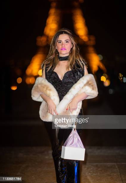 Carolina Ogliaro is seen wearing YSL pants Altaire bag Anissa Kermiche earrings Ronny Kobo top FuzzNotFur scarf during Paris Fashion Week Womenswear...