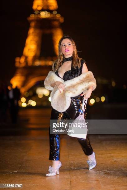 Carolina Ogliaro is seen wearing YSL pants Midnight 00 shoes Altaire bag Anissa Kermiche earrings Ronny Kobo top FuzzNotFur scarf during Paris...