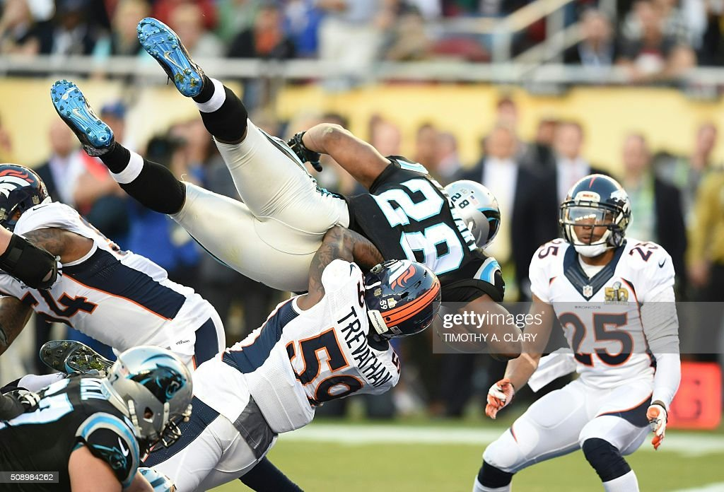 TOPSHOT - Carolina Panther Jonathan Stewart (28) jumps into the end zone for a touchdown during Super Bowl 50 against the Denver Broncos at Levi's Stadium in Santa Clara, California, on February 7, 2016. / AFP / TIMOTHY