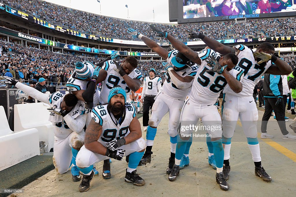 Carolina Panther teammates do 'the dab' during the finals seconds of the NFC Divisional Playoff Game at Bank of America Stadium on January 17, 2016 in Charlotte, North Carolina. The Carolina Panthers defeated the Seattle Seahawks 31-24.