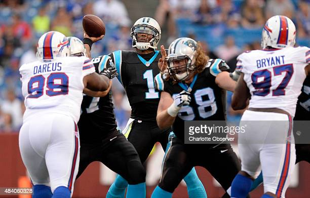 Carolina Panthers' Cam Newton throws downfield while playing against the Buffalo Bills in the first half of their preseason game at Ralph Wilson...